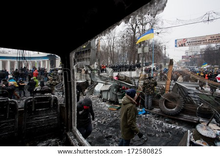 KYIV, UKRAINE - JAN 21: Barricades separated revolutionaries and the policemen on the occupying snow street during anti-government protest Euromaidan on January 21, 2014, in center of Kiev, Ukraine - stock photo