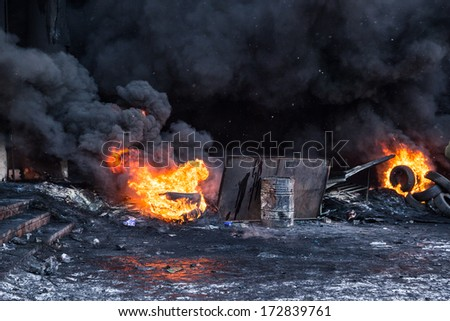 KYIV, UKRAINE - JAN 23: Fire in street during anti-government protest Euromaidan on January 23, 2014, in center of Kiev, Ukraine - stock photo
