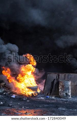 KYIV, UKRAINE - JAN 23: Fire in street during anti-government protest Euromaidan on January 23, 2014, in center of Kiev, Ukraine - stock photo
