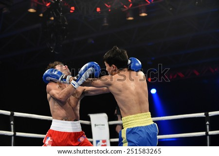 Kyiv, UKRAINE - January 23, 2014 : Andrew Selby (UK)  and Azat Usenaliev (UA) in the ring during boxing fight Ukraine Otamans vs British Lionhearts in Acco International center in Kiev, Ukraine