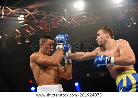 Kyiv, UKRAINE - January 23, 2014 : Joseph Joyce (UK) and Viktor Vykhrest (UA) in the ring during boxing fight Ukraine Otamans vs British Lionhearts fight in Acco International center in Kiev, Ukraine