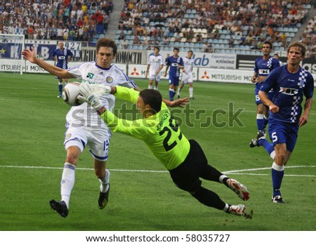 KYIV, UKRAINE - JULY 27, 2010: Denys Garmash of Dynamo Kyiv (L) fights for a ball with Bojan Jorgacevic (C) of Gent during their UEFA Champions League game on July 27, 2010 in Kyiv, Ukraine - stock photo