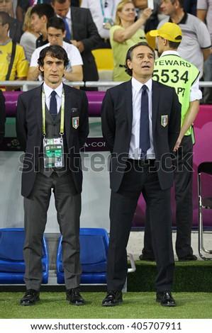 KYIV, UKRAINE - JULY 1, 2012: Head Coach of Italy national football team Cesare Prandelli (R) looks on during UEFA EURO 2012 Final game against Spain at Olympic stadium in Kyiv, Ukraine - stock photo