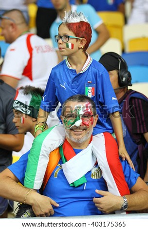 KYIV, UKRAINE - JULY 1, 2012: Italy national football team supporters show their support during UEFA EURO 2012 Championship final game at NSC Olympic stadium in Kyiv, Ukraine - stock photo