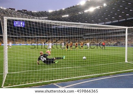 KYIV, UKRAINE - JULY 23, 2016: Junior Moraes of Dynamo Kyiv scores a penalty kick during Ukrainian Premier League game against FC Oleksandria at NSC Olympic stadium in Kyiv - stock photo