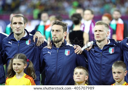 KYIV, UKRAINE - JULY 1, 2012: Players of Italy football team sing the national anthen before UEFA EURO 2012 Final game against Spain at Olympic stadium in Kyiv, Ukraine - stock photo