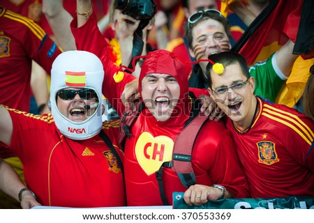 KYIV, UKRAINE - JULY 1: Spain  national football team supporters show their support during UEFA EURO 2012 Championship at Olympic stadium on July 1, 2012 in Kyiv, Ukraine - stock photo