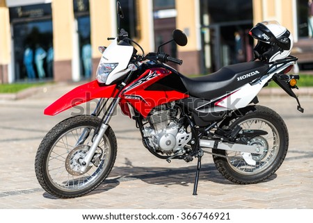 Kyiv, Ukraine - July 7th, 2015: Red motorcycle Honda XR 150L at the city street.