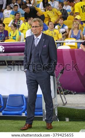 KYIV, UKRAINE - JUNE 11, 2012: Erik Hamren, head coach of Sweden National football team looks on during UEFA EURO 2012 game against Ukraine at Olympic stadium in Kyiv - stock photo