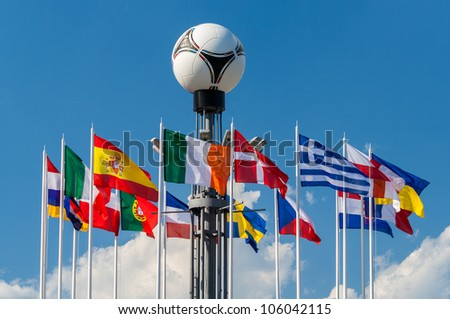 KYIV, UKRAINE - JUNE 19: National flags and Adidas tango 12, the official matchball of UEFA EURO 2012 on European Square on June 19, 2012 in Kyiv, Ukraine - stock photo