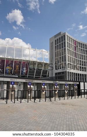 KYIV, UKRAINE - JUNE 2: National Olympic stadium in Kyiv (NSC Olimpiyskyi), the main Euro-2012 final game stadium, Western gates, main entrance on June, 2, 2012 in Kyiv, Ukraine - stock photo