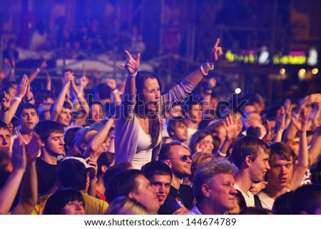KYIV, UKRAINE - JUNE 30: People dance during Queen performs onstage at charity Anti-AIDS concert at the Independence Square on June 30, 2012 in Kyiv, Ukraine - stock photo