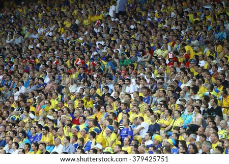 KYIV, UKRAINE - JUNE 11, 2012: People watch the UEFA EURO 2012 football game between Ukraine and Sweden at Olympic stadium in Kyiv - stock photo