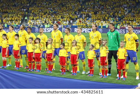 KYIV, UKRAINE - JUNE 19, 2012: Players of Sweden football team sing the national anthen before UEFA EURO 2012 game against France at Olympic stadium in Kyiv, Ukraine - stock photo