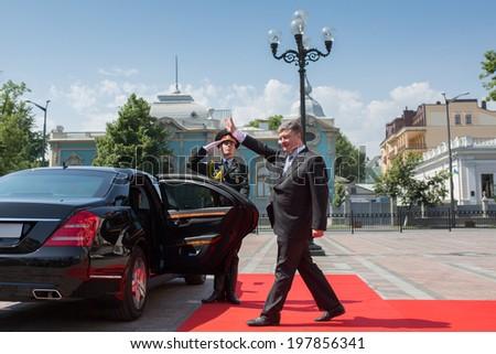 KYIV, UKRAINE - 08 JUNE 2014: President of Ukraine Poroshenko during the inauguration ceremony goes past the honor guard at the parliament the Verkhovna Rada of Ukraine. June 08, 2014 in Kyiv, Ukraine - stock photo