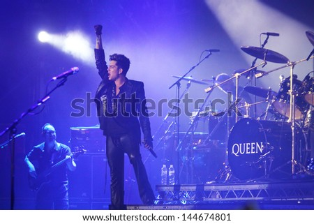 KYIV, UKRAINE - JUNE 30: Queen with Adam Lambert perform onstage during charity Anti-AIDS concert at the Independence Square on June 30, 2012 in Kyiv, Ukraine - stock photo