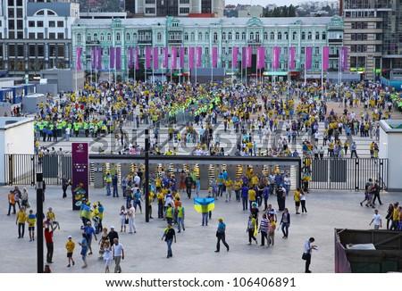 KYIV, UKRAINE - JUNE 11, 2012: Soccer fans go to the Olympic stadium (NSC Olimpiysky) before UEFA EURO 2012 game between Ukraine and Sweden on June 11, 2012 in Kyiv, Ukraine - stock photo