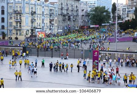 KYIV, UKRAINE - JUNE 11: Soccer fans go to the Olympic stadium (NSC Olimpiysky) before UEFA EURO 2012 game between Ukraine and Sweden on June 11, 2012 in Kyiv, Ukraine - stock photo