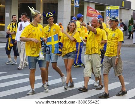 KYIV, UKRAINE - JUNE 11, 2012: Swedish football fans walk on the streets of Kyiv city before UEFA EURO 2012 game against Ukraine at Olympic stadium - stock photo