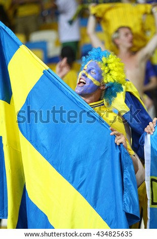 KYIV, UKRAINE - JUNE 19, 2012: Swedish football supporters show their support during UEFA EURO 2012 game against France at NSC Olympic stadium in Kyiv