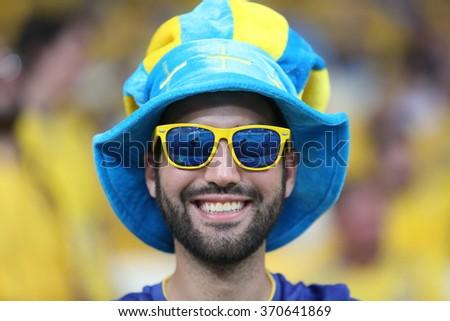 KYIV, UKRAINE - JUNE 19: Swedish national football team supporters show their support  before UEFA EURO 2012 game  on Olympic stadium (NSC Olimpiysky) on June 19, 2012 in Kyiv, Ukraine. - stock photo