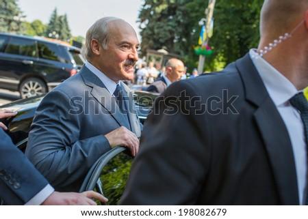 KYIV, UKRAINE - 08 JUNE 2014: The President of Belarus Alexander Lukashenko gets into the car visit the inauguration of Ukrainian President Petro Poroshenko. June 08, 2014 in Kyiv, Ukraine - stock photo