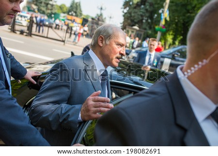 KYIV, UKRAINE - 08 JUNE 2014: The President of Belarus Alexander Lukashenko gets into the car visit the inauguration of Ukrainian President Petro Poroshenko. June 08, 2014 in Kyiv, Ukraine - stock photo