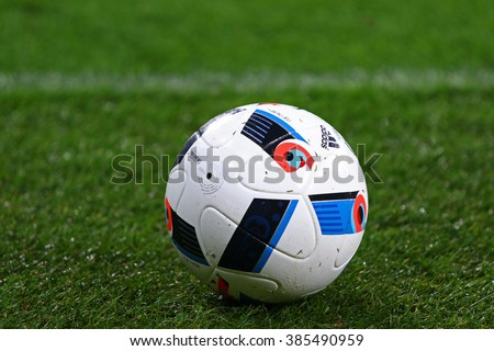 KYIV, UKRAINE - March 1, 2016: Adidas Beau Jeu - official match ball of the Euro-2016 on the grass during Ukrainian Cup quarterfinal first leg game FC Oleksandria vs FC Dynamo Kyiv in Kyiv - stock photo