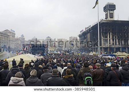 KYIV, UKRAINE -MARCH 2, 2014: Funeral folk meeting on Square of Independence for memory about Heroes of Sky Hundred was perished in Euromaidan occurrences; have been burned the House of Trade Unions