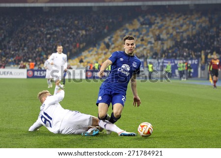 KYIV, UKRAINE - MARCH 19, 2015: Lukasz Teodorczyk of FC Dynamo Kyiv (L) fights for a ball with Seamus Coleman of FC Everton during their UEFA Europa League game at Olympic stadium in Kyiv - stock photo