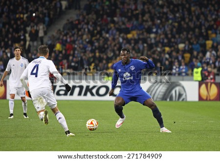 KYIV, UKRAINE - MARCH 19, 2015: Miguel Veloso of FC Dynamo Kyiv (L) fights for a ball with Romelu Lukaku of FC Everton during their UEFA Europa League game at Olympic stadium in Kyiv - stock photo
