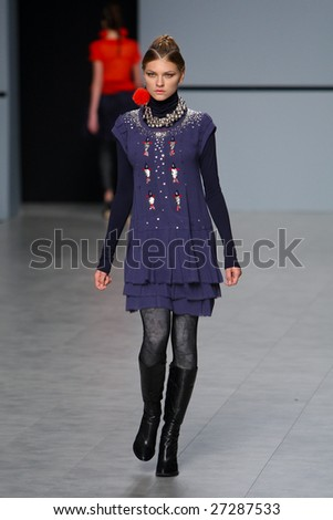 "KYIV, UKRAINE - March 13, 2009: Model walks the runway during Fashion Show by ""Nota Bene & Karavay"" as part of Ukrainian Fashion Week March 13, 2009 in Kyiv, Ukraine."