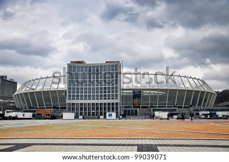KYIV, UKRAINE - MARCH 31: National Olympic stadium in Kyiv (NSC Olimpiys'kyi), the main Euro-2012 final game stadium, after reconstruction, gloomy weather on March 31st, 2012 in Kyiv, Ukraine - stock photo