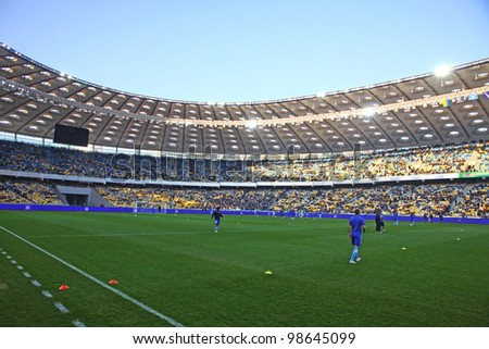 KYIV, UKRAINE - MARCH 18: Players run during training session before Ukraine Championship game between FC Dynamo Kyiv and FC Dnipro at NSC Olimpiyskiy stadium on March 18, 2012 in Kyiv, Ukraine - stock photo