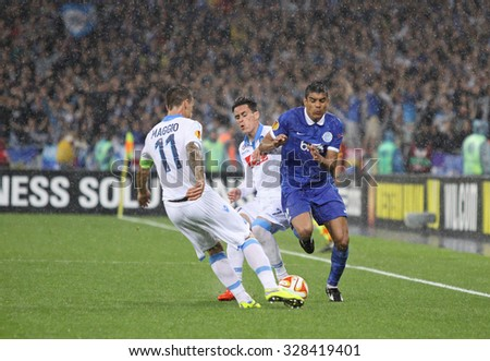 KYIV, UKRAINE - MAY 14, 2015: Leo Matos of FC Dnipro (R) fights for a ball with Christian Maggio (L) and Jose Callejon of SSC Napoli during their UEFA Europa League semifinal game - stock photo