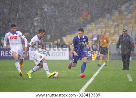 KYIV, UKRAINE - MAY 14, 2015: SSC Napoli and FC Dnipro players fight for a ball in heavy weather conditions during their UEFA Europa League semifinal game at NSK Olimpiyskyi stadium - stock photo