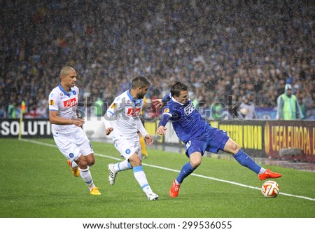 KYIV, UKRAINE - MAY 14, 2015: Yevhen Konoplyanka of FC Dnipro (R) fights for a ball with Lorenzo Insigne and Gokhan Inler of SSC Napoli during their UEFA Europa League semifinal gamestadium - stock photo
