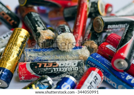 KYIV, UKRAINE - NOV 26: Many used batteries with layer of acidification on November 26, 2015. AA battery size was standardized by the American National Standards Institute in 1947  - stock photo