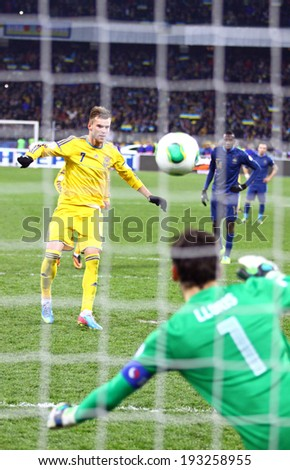 KYIV, UKRAINE - NOVEMBER 15, 2013: Andriy Yarmolenko of Ukraine scores a penalty during FIFA World Cup 2014 play-off game against France - stock photo