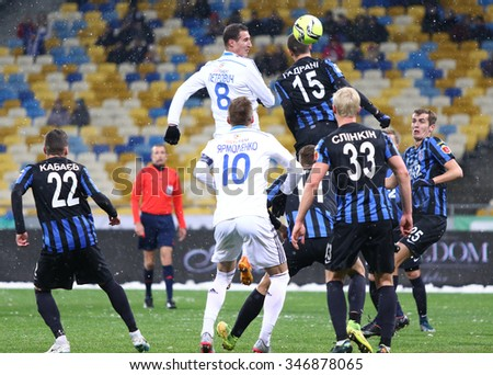 KYIV, UKRAINE - NOVEMBER 29, 2015: FC Dynamo Kyiv (in White) and FC Chornomorets Odesa players fight for a ball during their Ukrainian Premier League game at NSC Olimpiyskyi stadium - stock photo