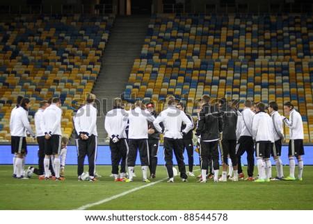 KYIV, UKRAINE - NOVEMBER 10: German national football team players listen to coaches during training session at NSK Olimpic stadium on November 10, 2011 in Kyiv, Ukraine - stock photo