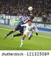 KYIV, UKRAINE - NOVEMBER 21: Gregory van der Wiel of FC PSG (L, #23) fights for a ball with Dudu of FC Dynamo Kyiv (R, #99) during their UEFA Champions League game on November 21,2012 in Kyiv, Ukraine - stock photo