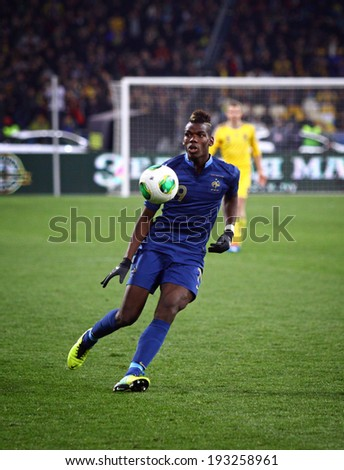 KYIV, UKRAINE - NOVEMBER 15, 2013: Paul Pogba of France control a ball during FIFA World Cup 2014 play-off game against Ukriane - stock photo