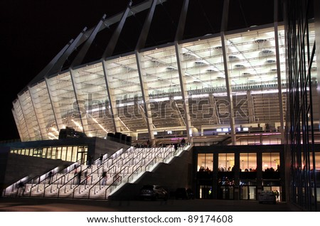 KYIV, UKRAINE - NOVEMBER 11: Visitors enter the Olympic stadium before friendly game between Ukraine and Germany on Nov.11,2011 in Kyiv, Ukraine. There is 1st game on this stadium after reconstruction - stock photo