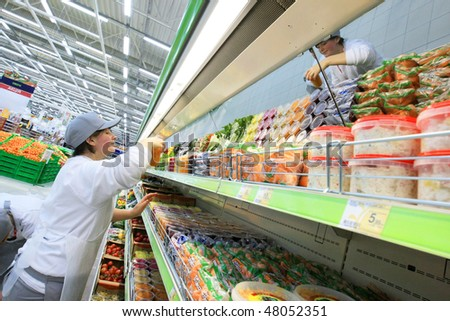 KYIV, UKRAINE - NOVEMBER 13: Worker in supermarket during preparation for the opening of the first store of OK supermarket network on November 13, 2007 in Kyiv, Ukraine. - stock photo