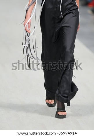 "KYIV, UKRAINE - OCT. 14: Model (foot model) walks the runway during Fashion Show by ""LITKOVSKAYA"" as part of Ukrainian Fashion Week, October 14, 2011 in Kyiv, Ukraine."