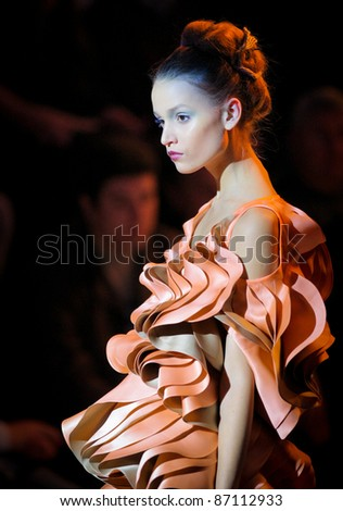 "KYIV, UKRAINE - OCT. 14: Model walks the runway during Fashion Show by ""BEKh"" as part of Ukrainian Fashion Week, October 14, 2011 in Kyiv, Ukraine. - stock photo"