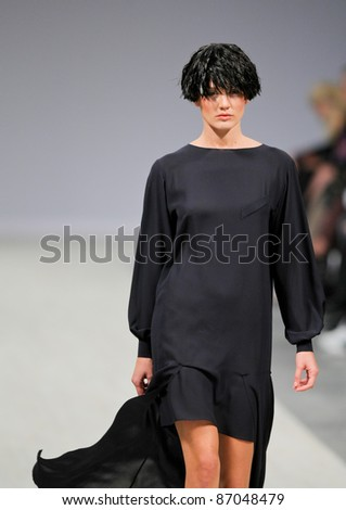 "KYIV, UKRAINE - OCT. 14: Model walks the runway during Fashion Show by ""BEVZA"" as part of Ukrainian Fashion Week, October 14, 2011 in Kyiv, Ukraine."