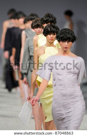 "KYIV, UKRAINE - OCT. 14: Models walk the runway during Fashion Show by ""BEVZA"" as part of Ukrainian Fashion Week, October 14, 2011 in Kyiv, Ukraine. - stock photo"