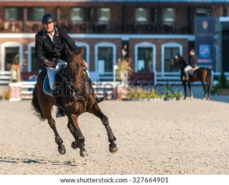 KYIV, UKRAINE - OCTOBER 10, 2015: A participant of competitions in jumping demonstration  during international equestrian tournament - stock photo